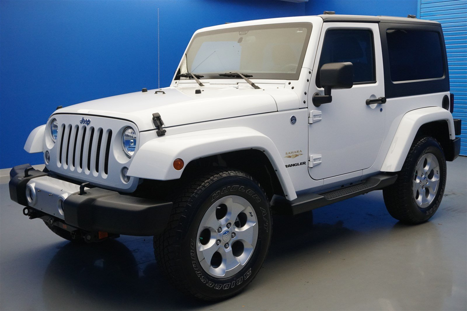 pre-owned 2015 jeep wrangler sahara convertible in jeffersonville